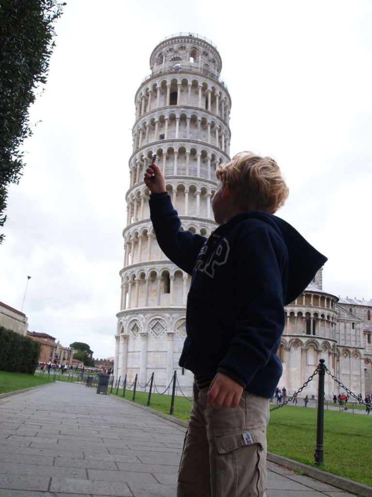 Lex compares his little Pisa Tower to the real one